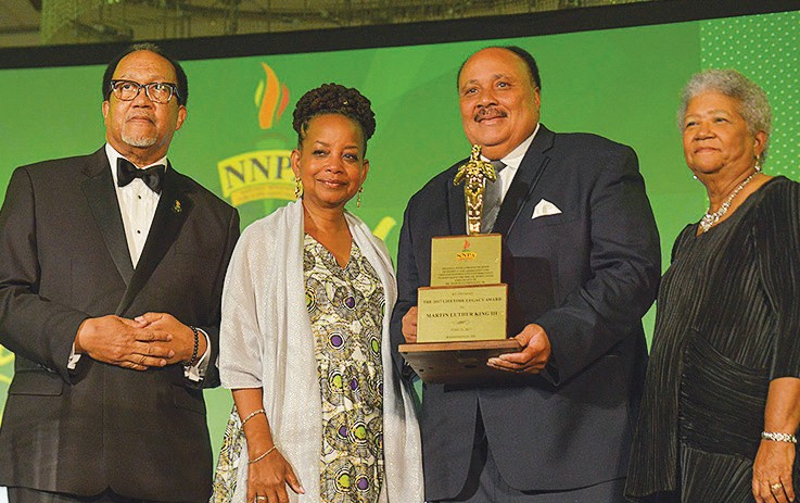 From left-right) Benjamin F. Chavis, Jr., president and CEO of the NNPA, Denise Rolark Barnes, outgoing chairman of the NNPA and Dorothy Leavell (far right) honor Martin Luther King III with the NNPA's Lifetime Legacy Award at the Legacy Awards Gala at the National Harbor in Prince George's County, Md., on June 23, 2017. (Freddie Allen/AMG/
