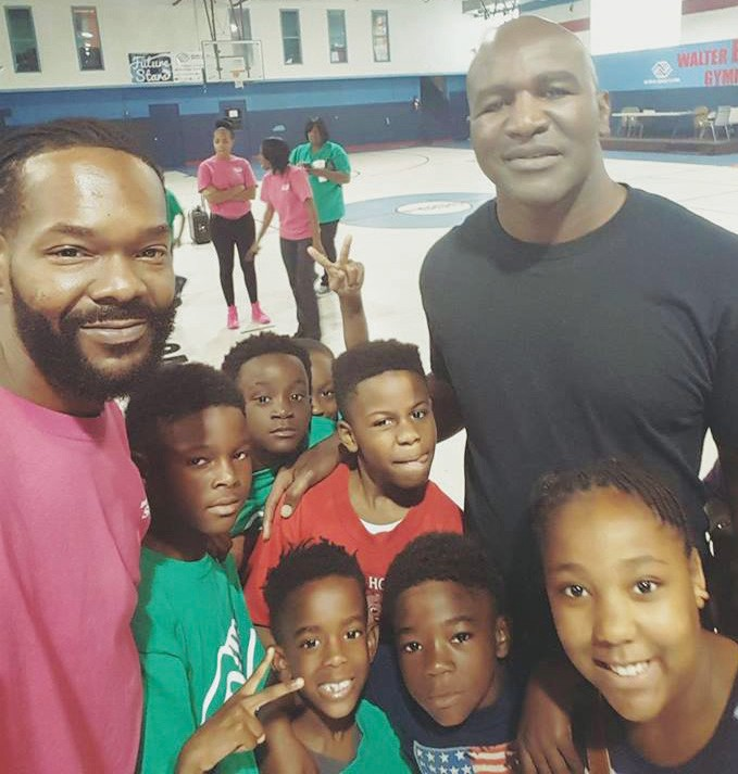 The Champ, Evander Holyfield, with the Frank Callen Boys & Girls Club kids.