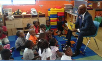 """Representative Edward """"Mickey"""" Stephens reads to the children at Wright's Child Care"""