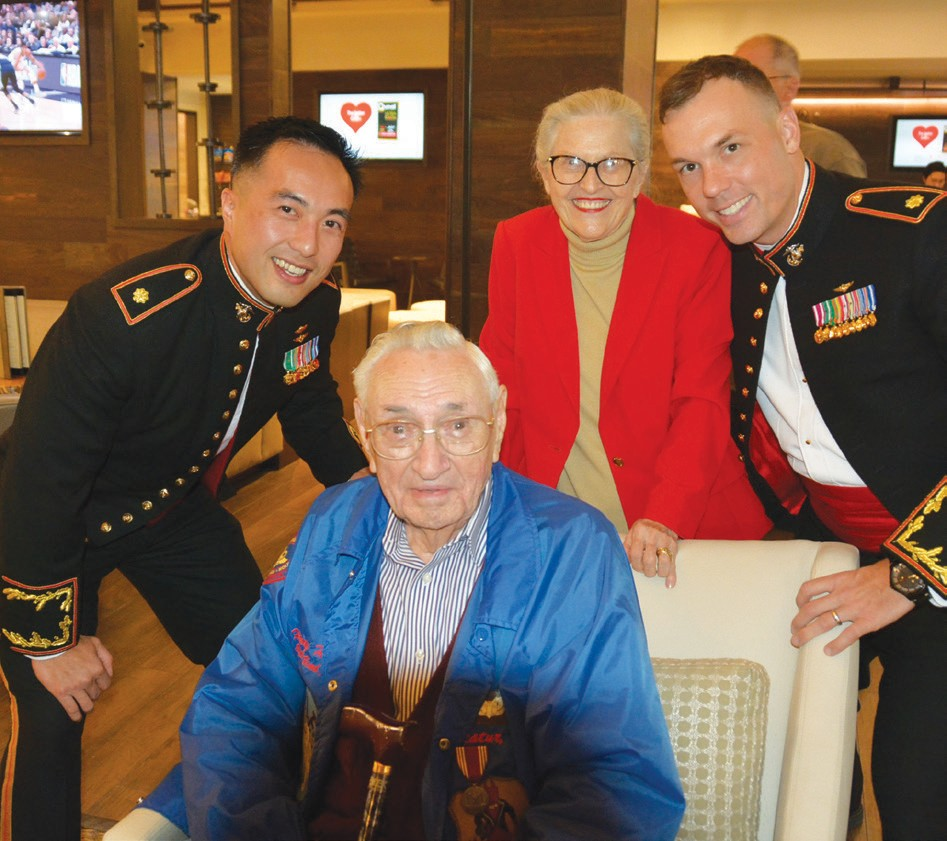 Henry Hughey (seated) shown with Marines during Veterans Day festivities