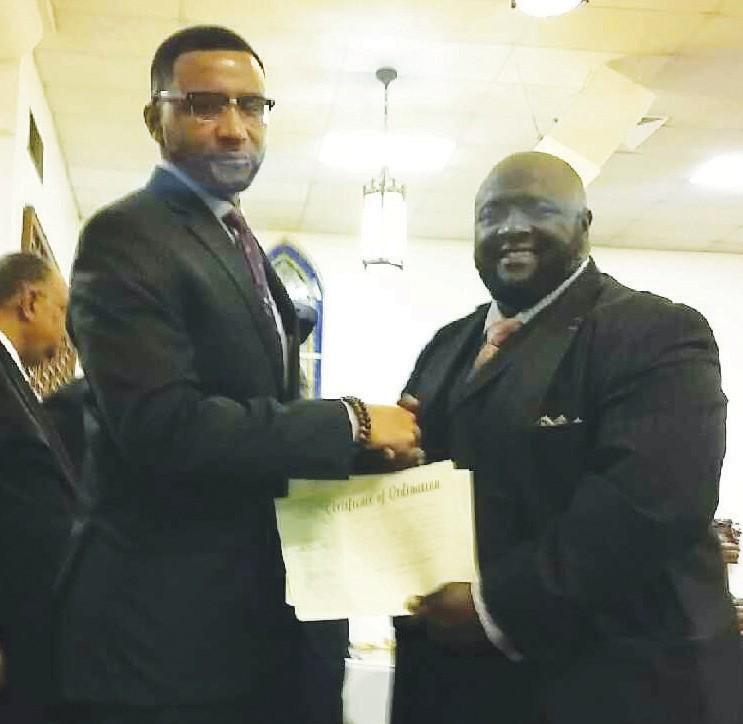 Rev. Quentin J. Morris, Sr. presents Rev. Paul Smith his Certificate of Ordination