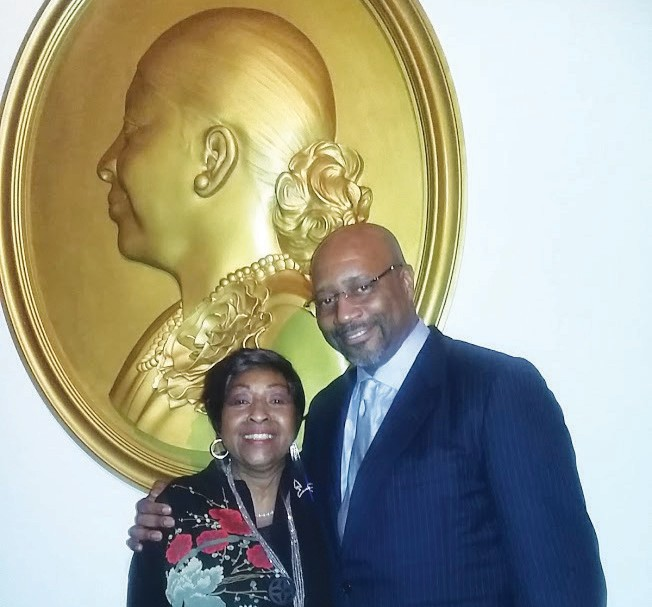 Women of Vision Honoree Edna B. Jackson shown with son Kevin Jackson at her protrait installation