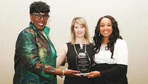 L-R: SCCPSS Superintendent Dr. Ann Levett, School Board President Jolene Byrne and Teacher of the Year Kiwonda Riley