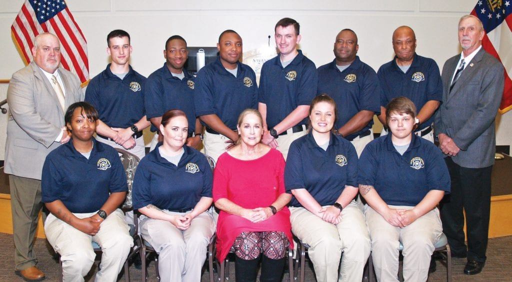 Group photo by Doug Currie. These ten graduates completed coursework containing the entire Georgia Peace Officer Standards and Training (P.O.S.T) Basic Law Enforcement Training Course and are qualified to be state-certified peace officers.