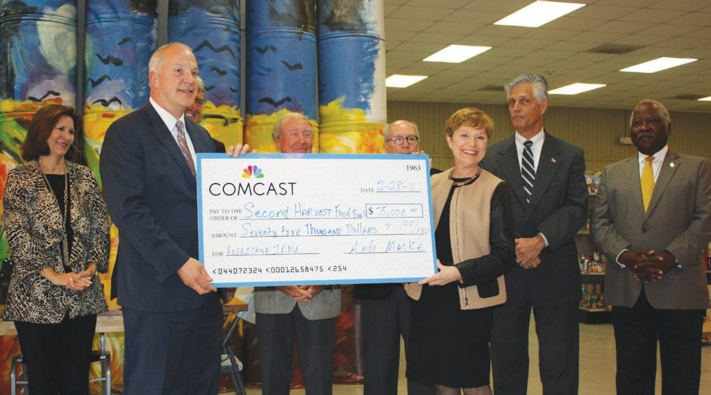 A check for $75,000 was presented to America's Second Harvest from Comcast in support of our relief efforts from Hurricane Irma. Andy Macke, Vice President of Big South Region for Comcast presented the check to Mary Jane Crouch, Executive Director, America's Second Harvest of Coastal Georgia. Also present were Second Harvest Board Members and Mayor Eddie DeLoach and Councilman John Hall.