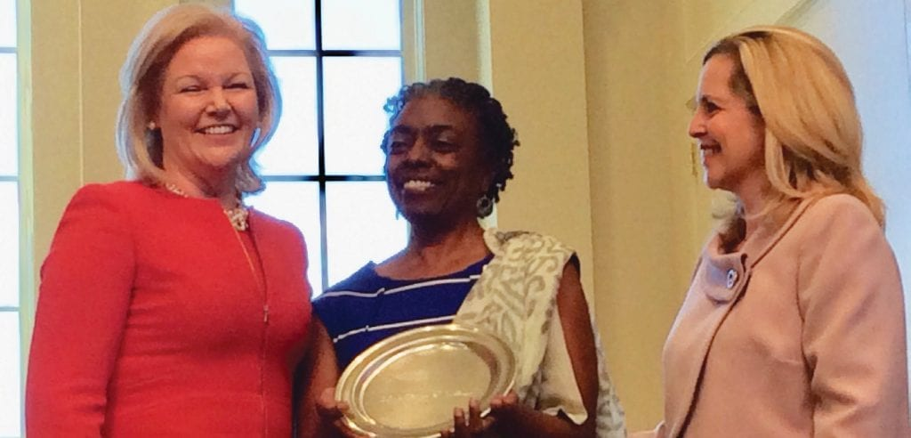 Photo above: Velma Thomas Fann, center, accepts award from Penny Elkins, PhD. (left) from Georgia Women of Achievement on behalf of inductee, Mamie George Williams.