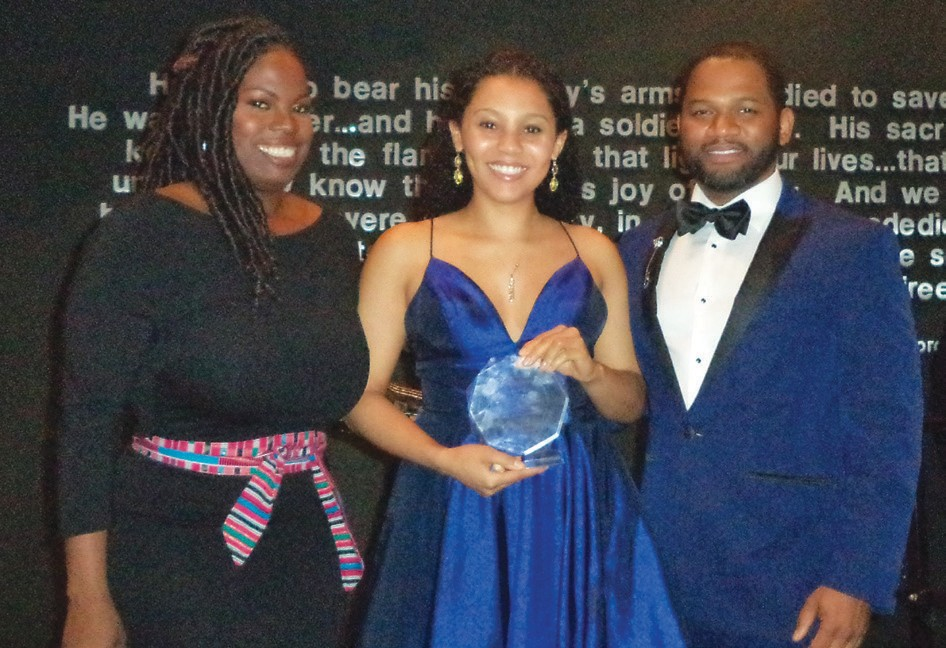 Meredith Stone (center) receives Innovation Award