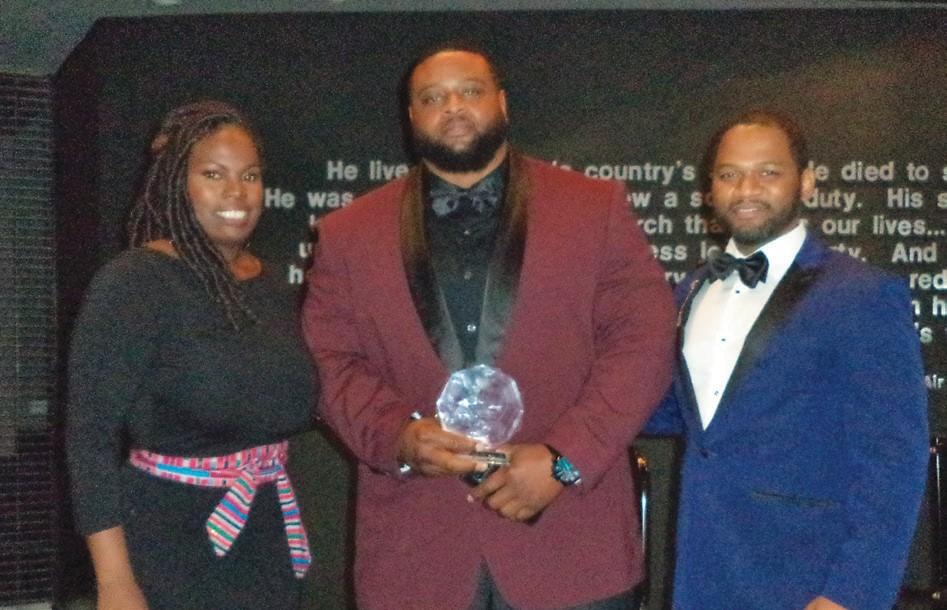 Alonzo Wright (middle) receives Entrepreneur Award