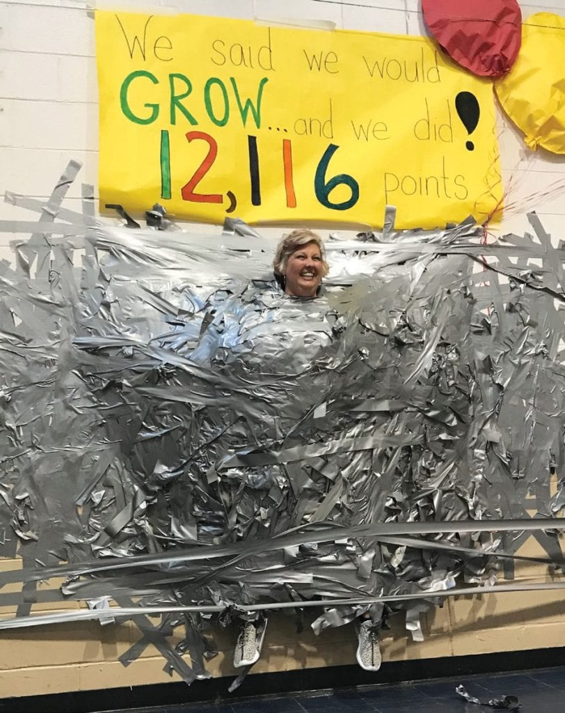 Principal Andrea Burkiett Duct taped to the wall