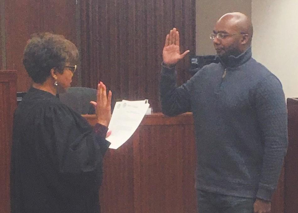 Antwan Lang sworn in by Judge Tammy Stokes