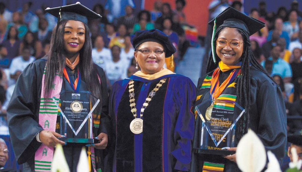Alicia Montgomery (left) and Rayne Clark (right) with Dr. Dozier. Photo: Litus Marshall