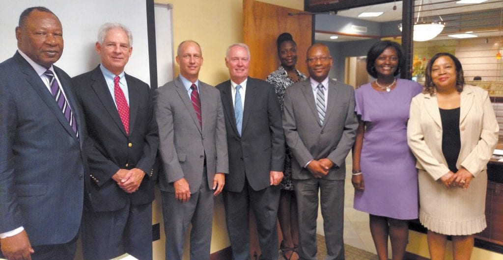 (L-R) Robert James, Walter Lewis of JC Lewis Ford, David Oliver and Joe Brannen with Carver Officers Alicia Gaffney, David Douse, Katrina Moultrie-Daniels, and Claudia Clarke.