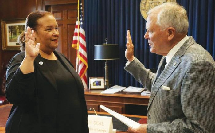 Robyn Crittenden (left) being sworn in by Gov. Nathan Deal