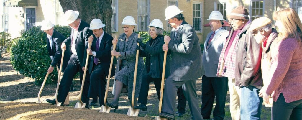 Executive Director Patti Lyons, Board Chair Jeff Kole, General Contractor Matt West along with volunteers leadership and SCI clients breaking ground.