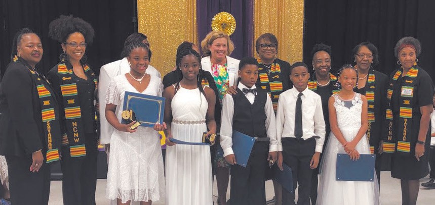 Row 1- Left to Right Denise Turner 3rd place, Alyssa Shelton 2nd place, NailLathan Kaymore 1st place, Tremaine Williams honorable mention, and Kayonna Mitchell honorable mention. Row 2- Left to Right Carrie Howard, NCNW, Life Member, Kai C. Walker, NCNW Member, Ms. Tina Hayward, Teacher at A.B. Williams, Betty Lasseter, NCNW, First Vice-President & Life Member, Susan Ambrose, Principal at A.B. Williams, Dr. Brenda Logan, NCNW member & Chair of Essay Committee, Annette Mitchell, NCNW member, Omie Flournoy, NCNW, Charter Member and Beatrice Campbell, NCNW, Life Member