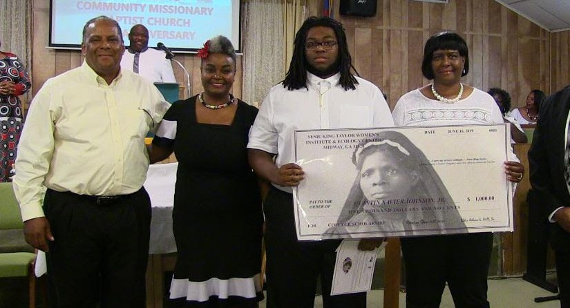 Quintin Johnson, Jr. (center) holding Susie King Taylor scholarship check with his parents (right) as institute founders (left) look on.