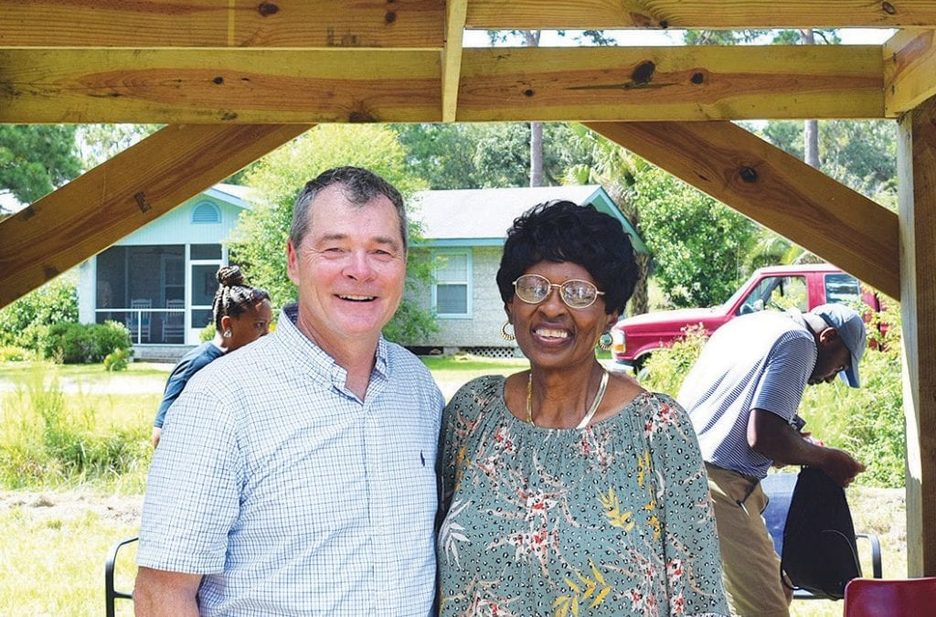 Tim Echols, left, Vice-Chair of the Georgia Public Service Commission, stands with Dr. Carolyn Dowse, who was instrumental in starting the Hog Hammock Library and for whom the new solar pavilion is named.
