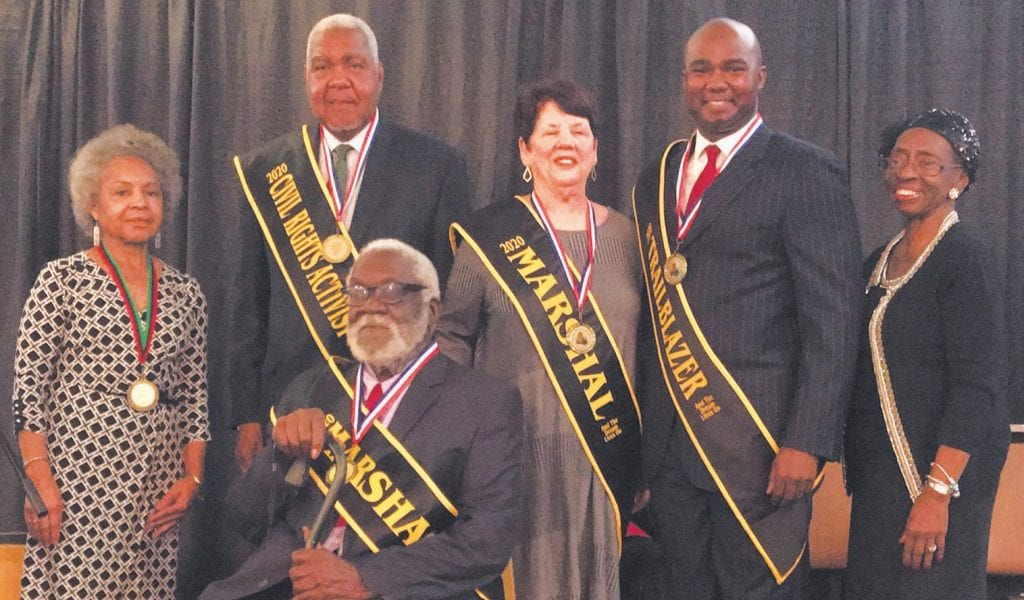 Sashing of the 2020 MLK Observance Day Association Honorees performed by Dr. Carolyn Brown (L) and Mrs. Carolyn Blackshear (R). Honorees (Standing L-R): George Shinhoster, Civil Right Activist; Maxine Patterson, Parade Marshal; Antwan Lang, Trailblazer Award; & (Seated): Lt. John White, Parade Marshal.