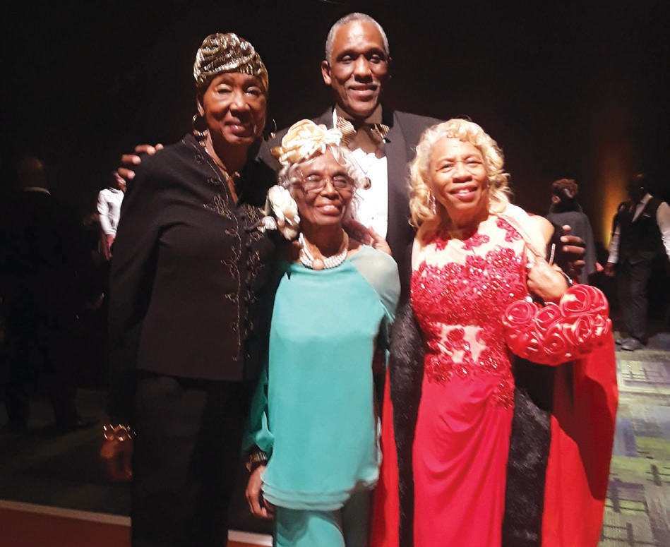 L-R: Alma Burney represented the class of 1967 debutantes, Jessie Collier DeLoach (center) represented 1946 Debutante class, pictured with Alpha Phi Alpha President Solomon Myers