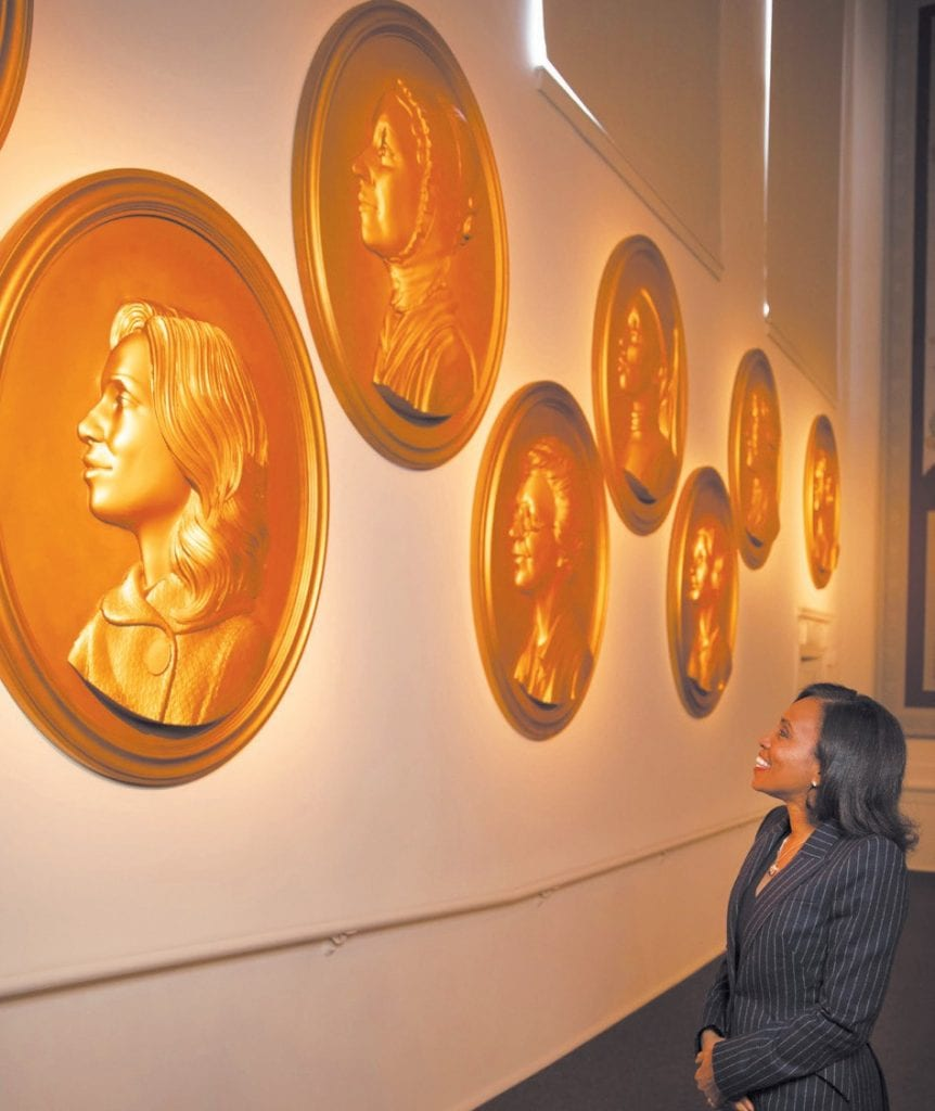 2020 Savannah Women of Vision Honoree Suzanne Shank's gold relief portrait was hung in Arnold Hall on Friday. The portrait was hand carved by SCAD alum Michael Porten.