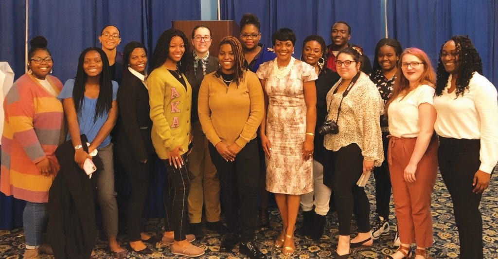 Tina Tyus-Shaw (center) poses with students across the region who won awards in the Publication Contest