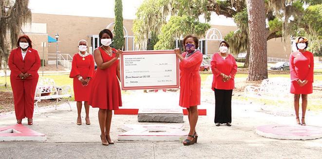 Edna Branch Jackson presents the donation to SSU Interim President Kimberly Ballard-Washington