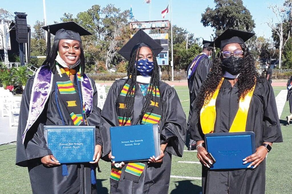 Aurelle Ross (right) with fellow graduates