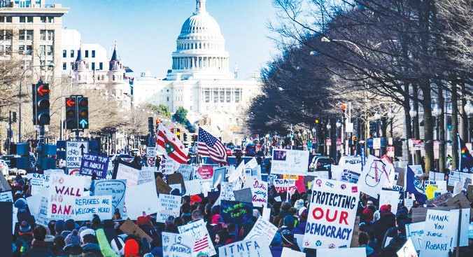 Protesters march toward the Capitol before a group stormed the building Wednesday afternoon