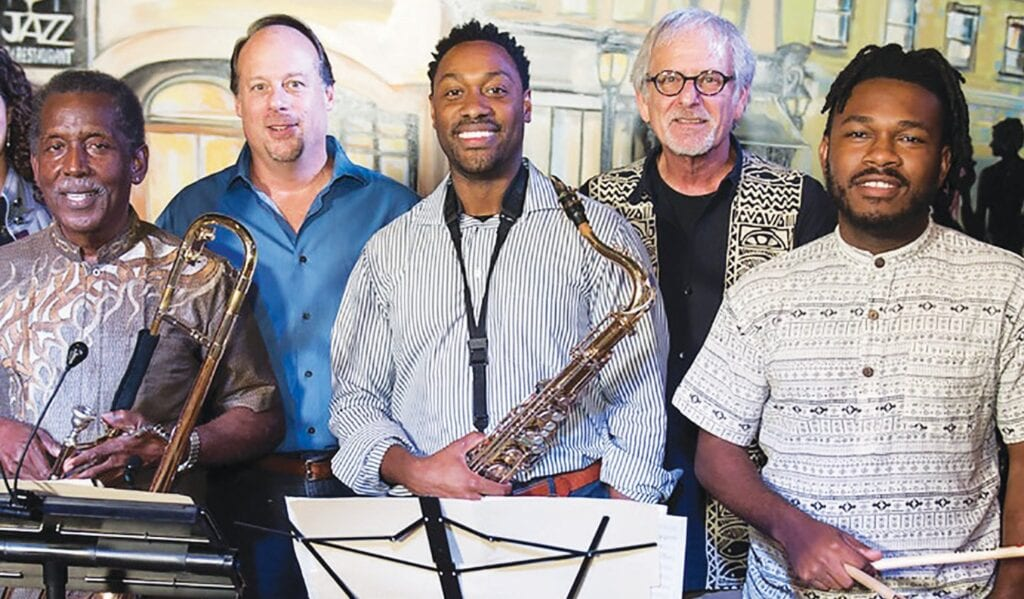 L-R: Teddy Adams (Trombone), Kirk Lee (Trumpet), Calvin Barnes (Saxophone), Mitch Hennes (Bass) and Robert Saunders (Drums)