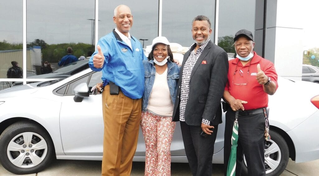 L-R: Jesse Greathouse, Rincon Chevrolet General Manager; Pamela Flower, (car recipient); Pastor George P. Lee (St. John Baptist Church) & Deacon Myles