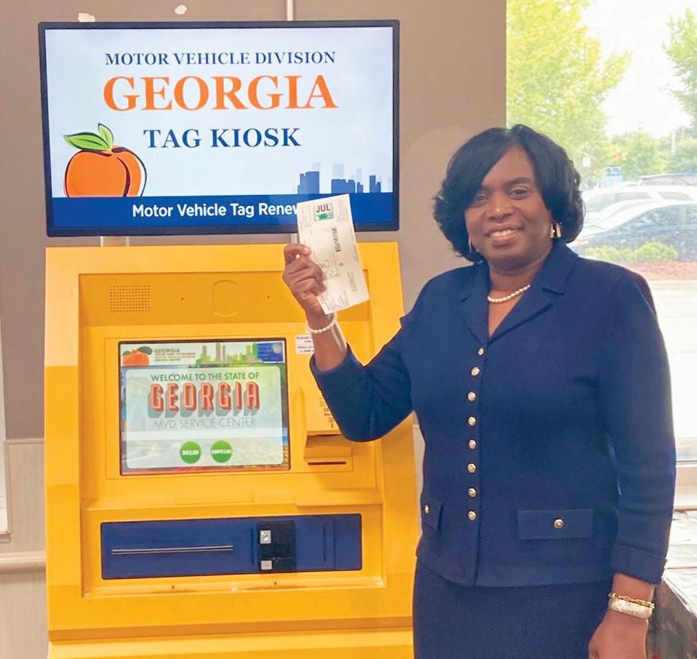 Sonya L. Jackson with automated renewal kiosk